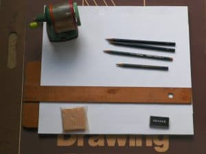 Drawing board with supplies on top
