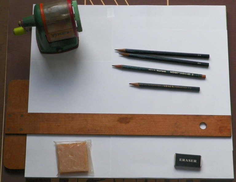 drawing board with art equipment