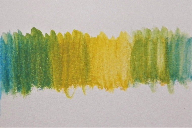 Mixing yellow and blue watercolor pencil technique